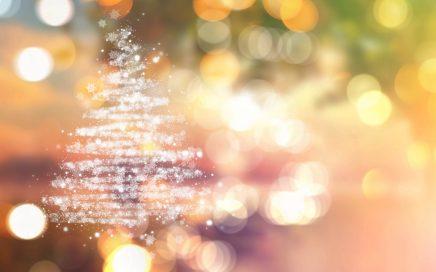Christmas tree of stars on a bokeh lights background